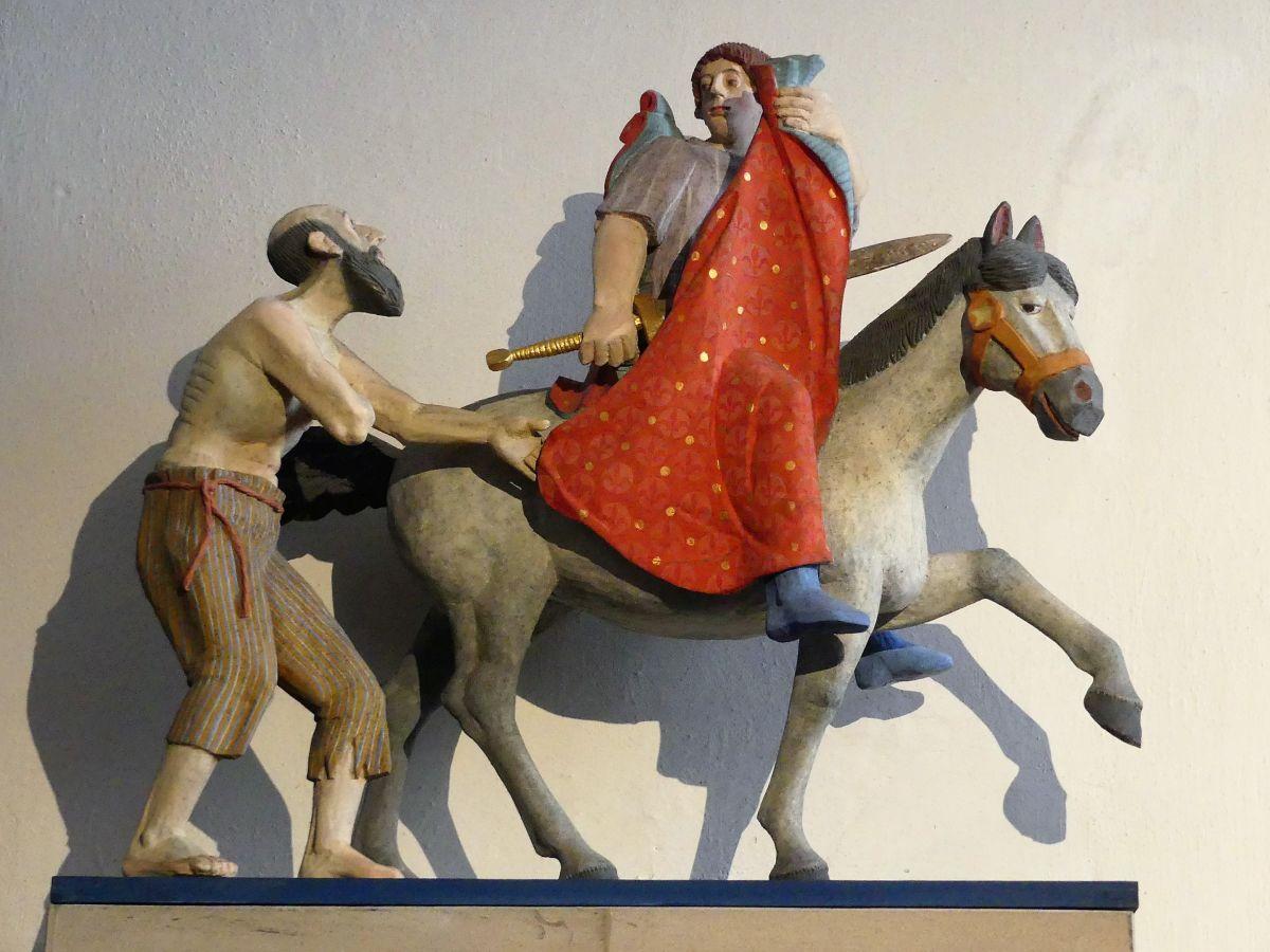 Skulptur von St. Martin auf dem Pferd und dem Bettler daneben.