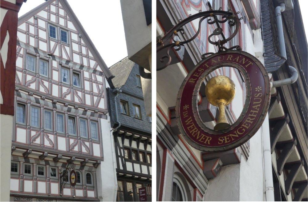 Fachwerkfassade und Gasthausschild.